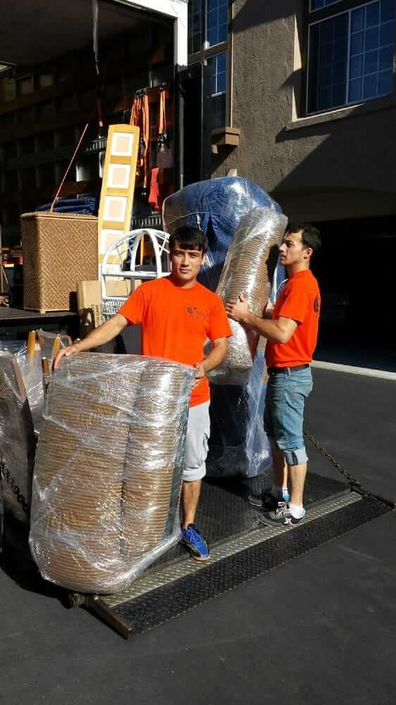 orange county movers packing items into warehouse