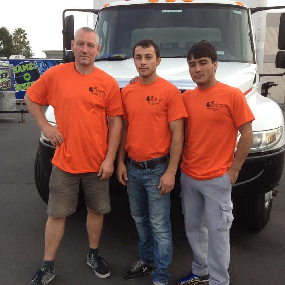 Professional orange county movers in front of the moving van