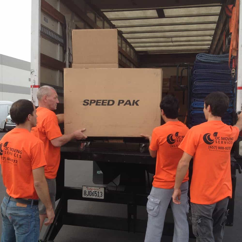 Orange County movers loading a box into a moving truck