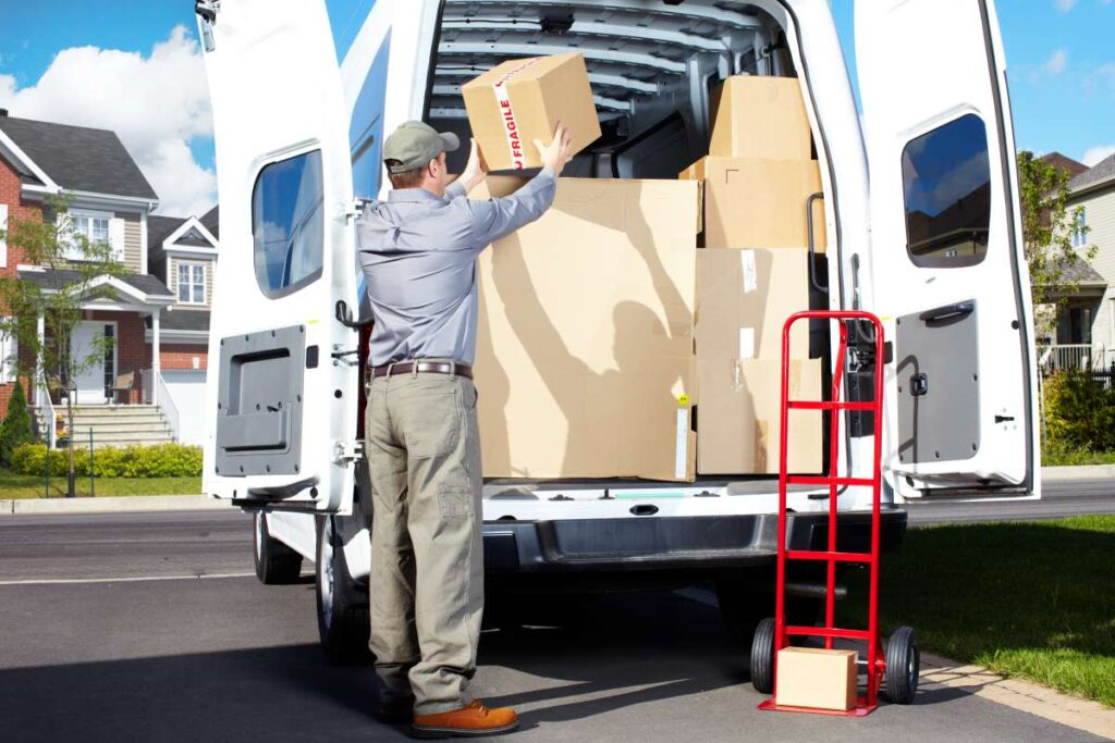 Professional movers in Orange County loading a vehicle