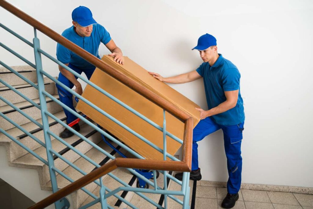 Professional movers in Orange County carrying a shelf